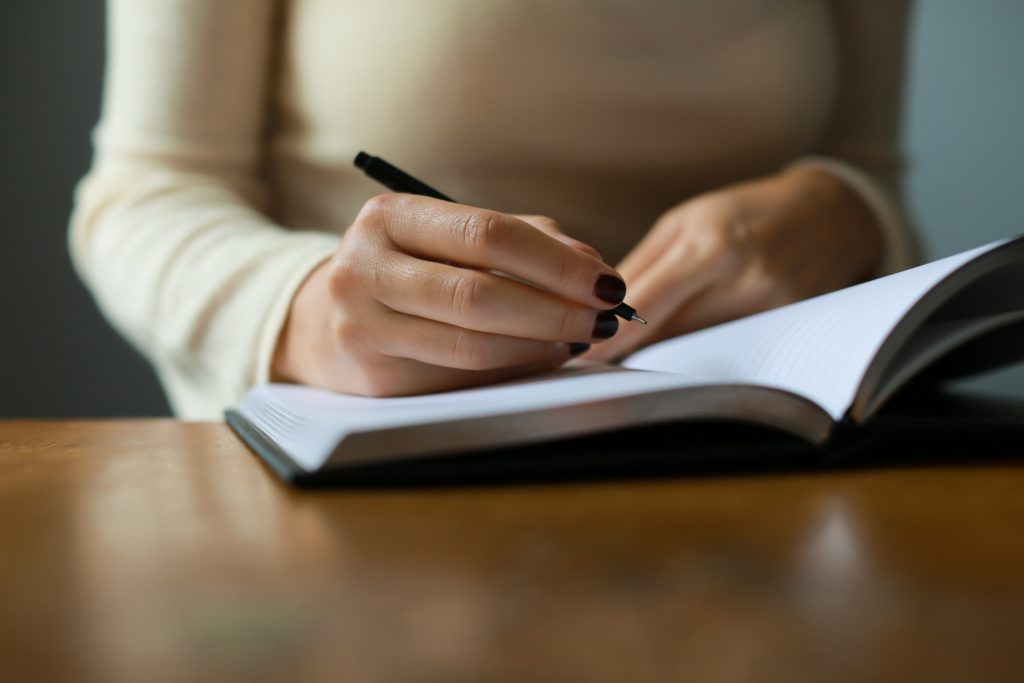 Professional women writing notes