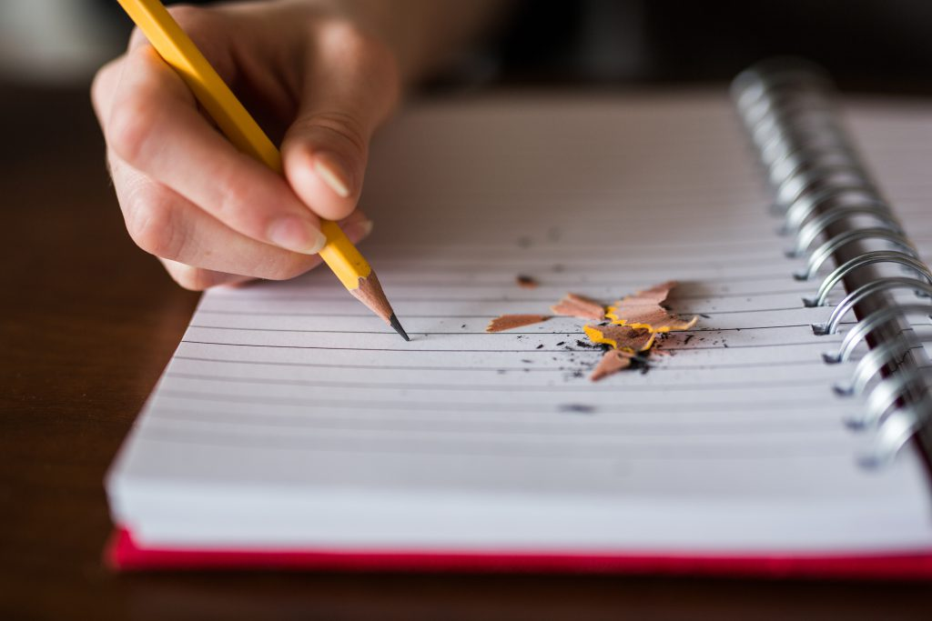 Yellow pencil and notebook