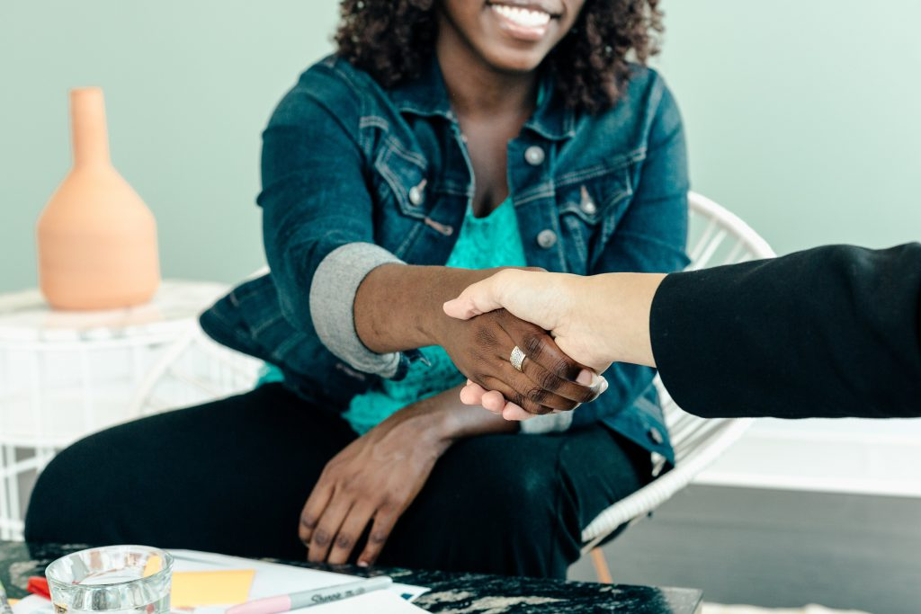 Woman shaking hand at end of a meeting